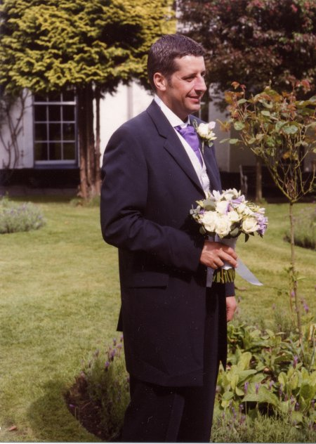 Groom with posy